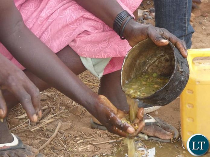 Villagers preparing Baobab fruits for a meal
