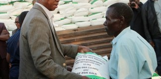 President Lungu dinating a Melalie meal bag to a draght viction