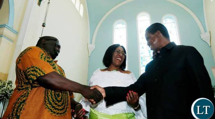 President Edgar Chagwa Lungu (right) extends his hands to Chishimba Kambwili (left)