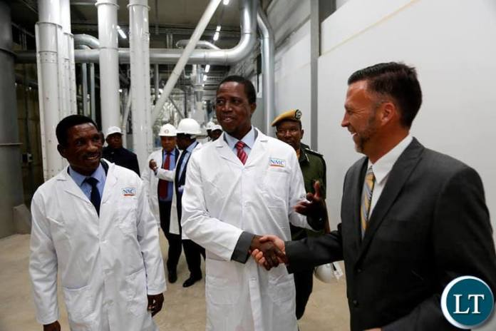 President Edgar Chagwa Lungu (centre) accompanied by Minister of Agriculture Michael Katambo (left) and National Milling Corporation Managing Director David Bosse tour the Ultra Modern New Mill in Lilayi, Lusaka on Friday, October 11,2019 .