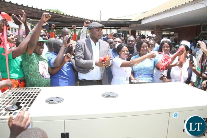 Kabushi Member of Parliament Bowman Lusambo hands over one of the four power gensets to Kabushi clinic on Saturday