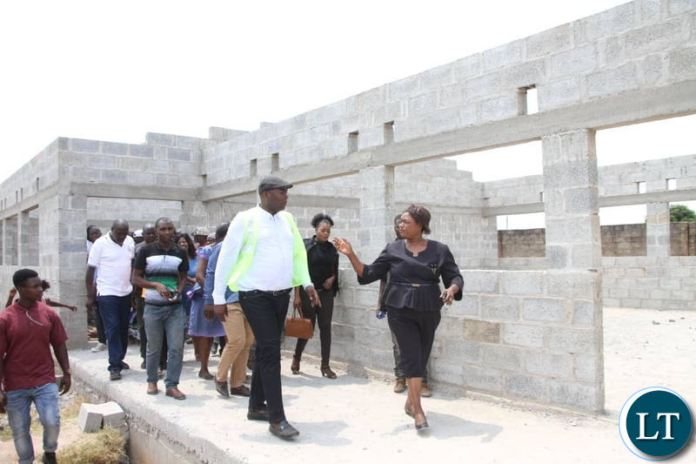 Kabushi Member of Parliament Bowman Lusambo tours the incomplete structure meant for a Maternity Annex at Kabushi Clinic on Saturday