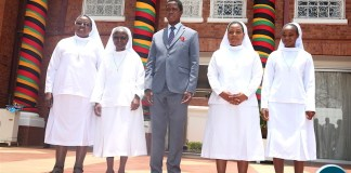 President Lungu and Secretary to the Cabinet Dr Simon Miti poses for a photograph with Catholic Sisters from Cheshire home-Kabulonga, who paid a Courtesy call on the Head of State at State House on Friday, November 8,2019 -Pictures by THOMAS NSAMA