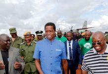 President Edgar Chagwa Lungu (centre) accompanied by Northern Province Minister Bwalya Chungu (left) and Kasama Member of Parliament Kelvin Sampa (right) at Kasama Airport in
