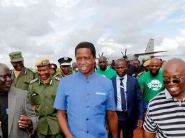 President Edgar Chagwa Lungu (centre) accompanied by Northern Province Minister Bwalya Chungu (left) and Kasama Member of Parliament Kelvin Sampa (right) at Kasama Airport in