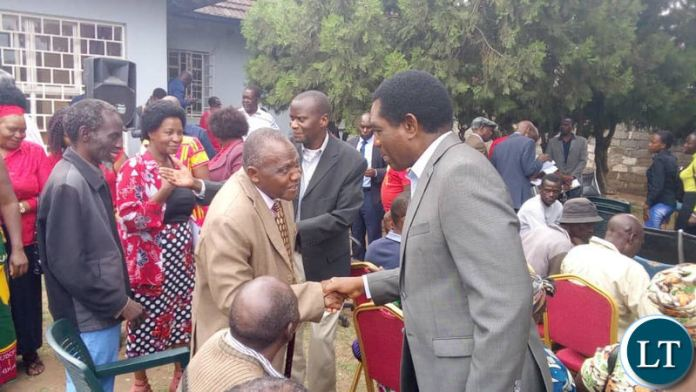 UPND leader Hakainde Hichilema greets ZSIC retirees who called on him at the party secretariat