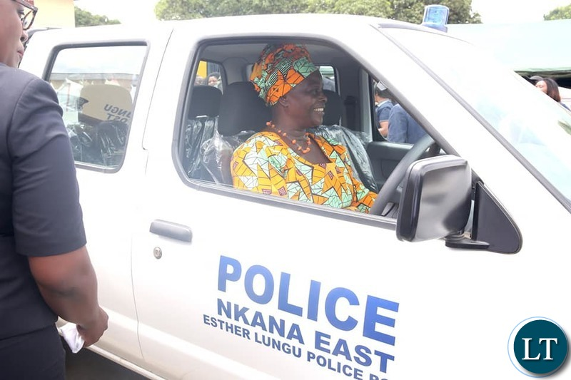 First Lady Esther Lungu Test Driving  the  $36,000 brand new Nissan Hard body 4×4 Motor Vehicle donated to  the modern Esther Lungu Police Post.