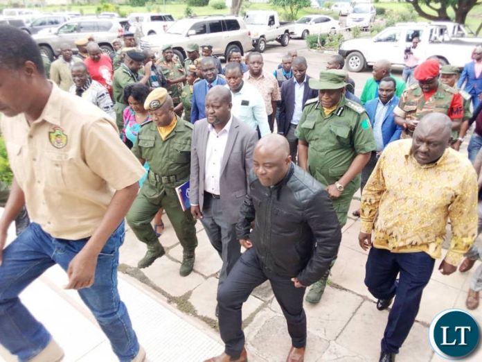 Defence Minister Davies Chama and Home Affairs Minister Stephen Kampyongo flanked by Police Inspector General Kakoma Kanganja arriving in Chingola on Sunday