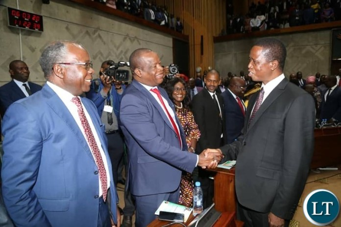 President Lungu Shaking hands with UPND Members of Parliament Situmbeko Musokotwane and Jack Mwiimbu