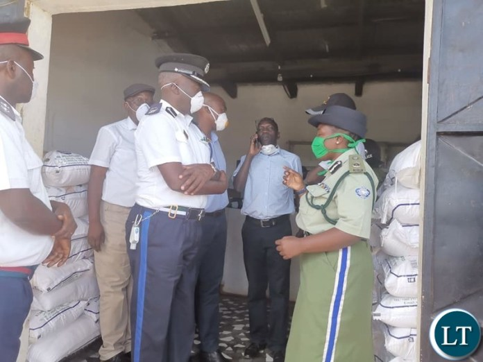 Copperbelt Minister Mr Mwakalombe flanked by Copperbelt Police Commsioner Charity Katanga, NCC Town clerk Wisdom Bwalya , District Commsioner Anthony Katongo and other officials