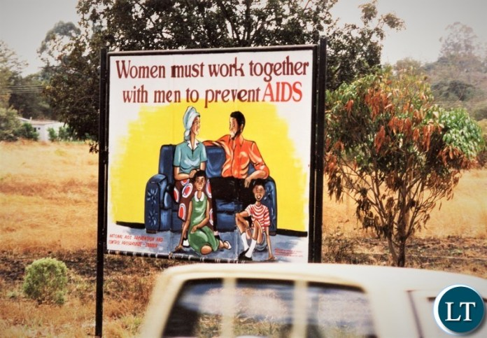 AIDS – A sign about HIV/AIDS prevention near the present day Manda Mall on the Great East Road in Lusaka in 1993.