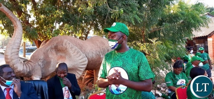 Patriotic Front Lusaka Province Youth Chairperson Danniel Kalembe making a speech during the donation of materials to fight COVID-19