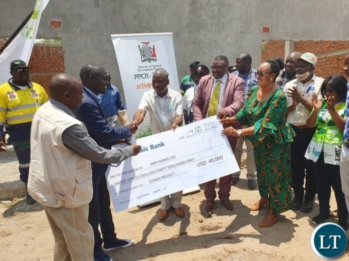Danies Chisenda hands over check worth USD 40, 000 grant in chibombo 29-10-2020
