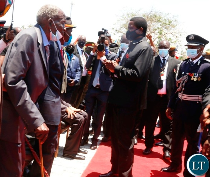 President Edgar Lungu talks to Freedom fighters John Monze 98 (left) and Jackson Bwalya aged 103 years during the remembrance day at the national Cenotaph in Lusaka.Picture by SUNDAY BWALYA/ZANIS.