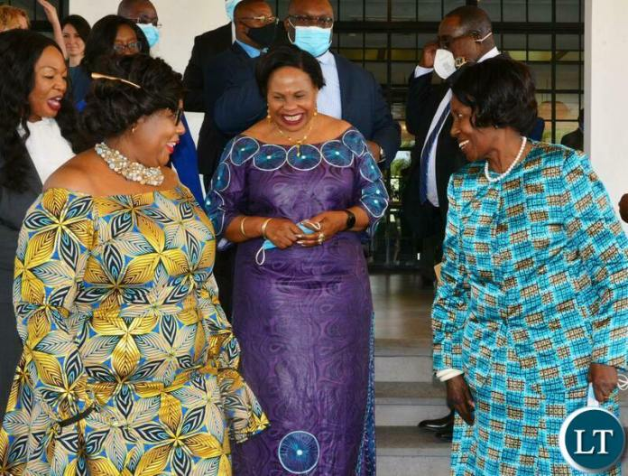 Vice-President Inonge Wina in a conversation with Minister of Information ,Publicity and information of Zimbabwe, Monica Mutsvangwa(M) during the World Communication Forum -Africa in Lusaka. Looking on is Minister of Information, Dora Siliya