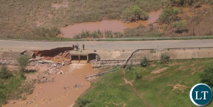 45% washed aways mambwa bridge along landless corner road in Mumbwa District after the Kandesha dam burst it banks creating flash floods yesterday. Sunday, December 27, 2020. Picture by ROYD SIBAJENE/ZANIS