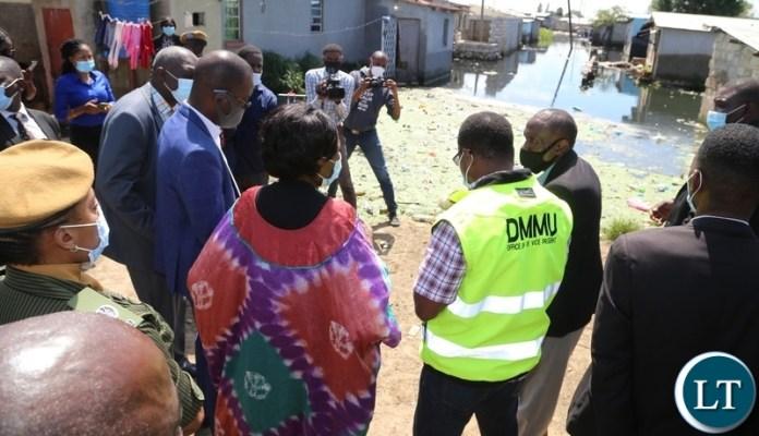 Vice President Inonge Wina with DMMU National Coordinator Chanda Kabwe inspecting the flood houses in Kuku compound