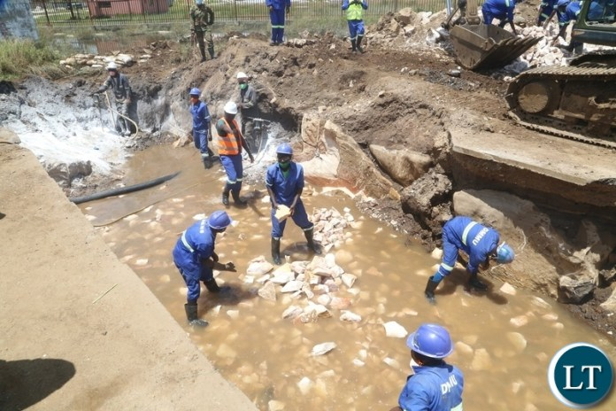 Engineers from ZNS and Zambia Army working on the drainage system being built to help flooding off Kanyama area at road 55