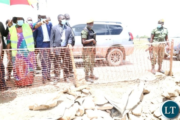 Vice President Inonge Wina inspecting the drainage system being built to help flooding off Kanyama area at road 55