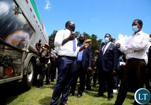 Minister of youth and sports Emmanuel Mulenga (left) explains how the fuel tankers the Government has bought for youths will be operated during this year's youth day commemorations at Mulungushi conference centre in Lusaka. Picture by SUNDAY BWALYA/ZANIS