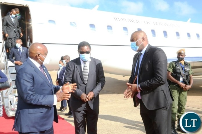 President of Botswana Dr. Mokgweesti Eric Masisi confers with Minister of Foreign Affairs Joseph Malanji and Lusaka Province Minister Bowman Lusambo on his arrival at Kenneth Kunda International airport yesterday, Wednesday, March 31, 2021. Picture by ROYD SIBAJENE/ZANIS