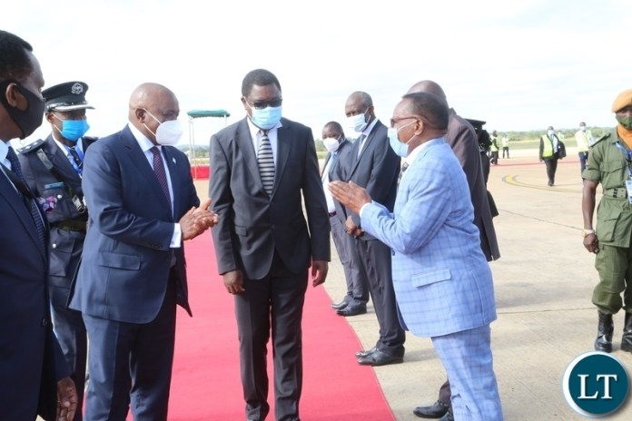 President of Botswana Dr. Mokgweesti Eric Masisi confers with Minister of Foreign Affairs Joseph Malanji greet Botswana's officials on his arrival at Kenneth Kunda International airport yesterday, Wednesday, March 31, 2021. Picture by ROYD SIBAJENE/ZANIS