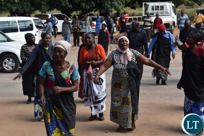 Women from the Mukuni Royal Establishment of Kazungula District yesterday protested outside the Livingstone Central police station demanding the release of Chief Mukini's wife who was arrested on Monday. Picture by KELVIN MUDENDA