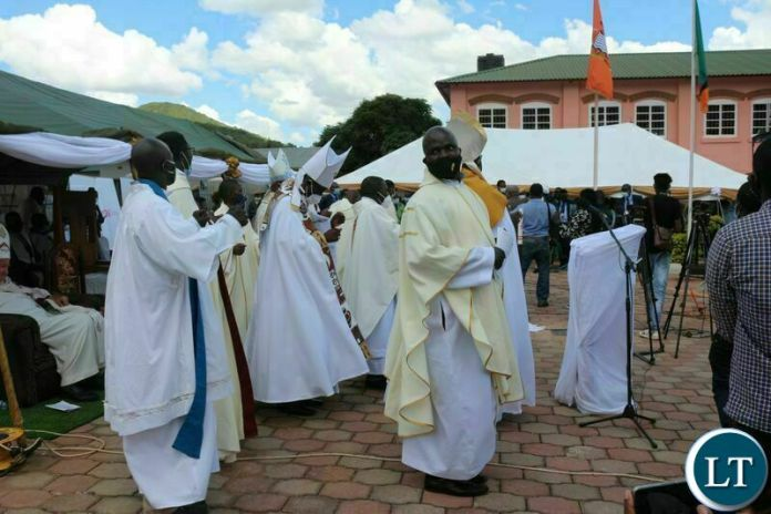 THE Anglican Church clergy dance to a song during the commissioning of the John Osmas Anglican church building in Chipata yesterday. PICTURE BY STEPHEN MUKOBEKO/ZANIS