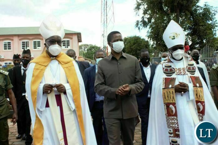 PRESIDENT Edgar Lungu, Anglican Archbishop of Central Africa, Albert Chama ( r) and Anglican Bishop of Eastern Zambia, William Mchombo, after the commissioning of the John Osmas church building in Chipata yesterday. PICTURE BY STEPHEN MUKOBEKO/ZANIS