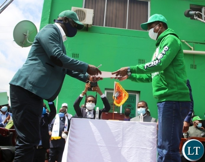 President Edgar Lungu hands in his nomination papers to PF Party Secretary General Davies Mwila during the filling in of nominations at the PF Secretariat. Picture by SUNDAY BWALYA/ZANIS