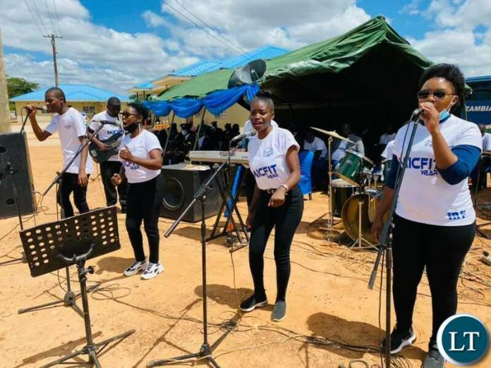 A band performing at the ceremony to  commission and hand over six housing units constructed by ZTE in Chongwe