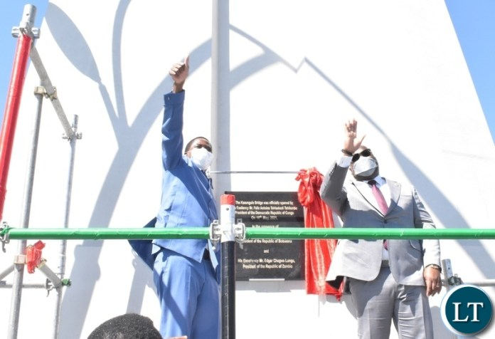 DRC President Felix Tshisekedi and President Edgar Lungu waving to the crowd after officially opening the newly constructed Kazungula bridge