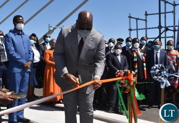 DRC President Felix Tshisekedi cutting the ribbon to officially open the newly constructed Kazungula bridge