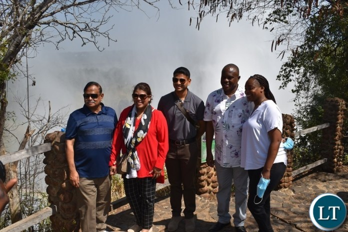 Zambia Army Commander William Sikazwe( in white shirt) with visiting  Bangladesh Chief of Army  Staff General Aziz Ahmed(in blue t-shirt) pose for a photo with their spouses at the Victoria Falls World Heritage Site in Livingstone. Picture by KELVIN MUDENDA