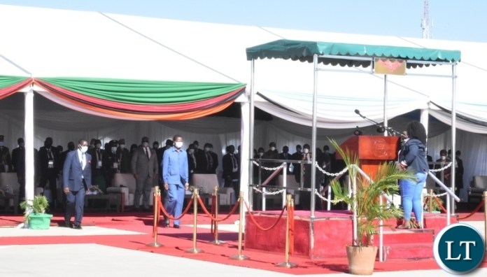 President Edgar Lungu walks to the podium to deliver his speech during the official opening of the Kazungula Bridge