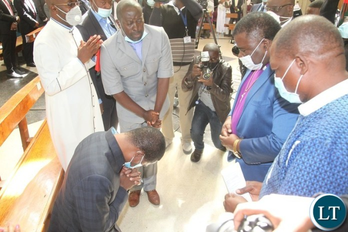 PRESIDENT Edgar Lungu being prayed for during the National Prayer initiative for 2021 peaceful elections at Cathedral of the Holy Cross in Lusaka.