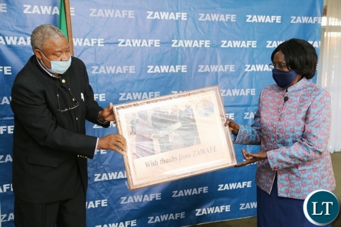 Vice President Inonge Wina receive a present from Zambia Water Forum Exhibition Chairperson Imasiku Nyambe, the present is for her contribution towards the water sector shortly after the virtual meeting yesterday. Monday, June 7, 2021. Picture by ROYD SIBAJENE/ZANIS