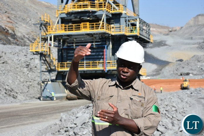 KALUMBILA Minerals Limited Project Manager for CR4 Pocket Construction Albert Jonah explains the effectiveness of the In-pit ore crushers at Kalumbila Open pit mine. – Picture by Derrick Silimina/SUMA SYSTEMS.