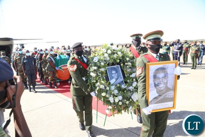 Men in uniform carrying the remains of the late first Zambian President Dr Kenneth Kaunda at Simon Mwansa Kampwepwe international airport yesterday. Monday, June 28, 2021. Picture by ROYD SIBAJENE/ ZANIS