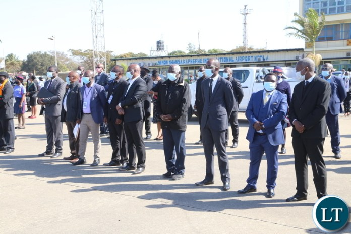 Senior Civil Servants in Ndola awaits to receive the remains of the late first Zambian President Dr Kenneth Kaunda at Ndola airport yesterday. Monday, June 28, 2021. Picture by ROYD SIBAJENE ZANIS