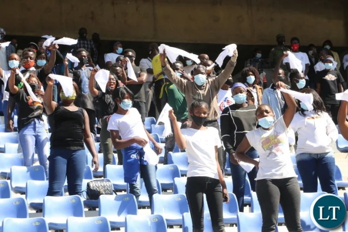 Ndola residents mourn the late first Zambian President Dr Kenneth Kaunda by waving white handkerchiefs a symbol for the late when the remains where being driven through Ndola town yesterday. Monday, June 28, 2021. Picture by ROYD SIBAJENE ZANIS