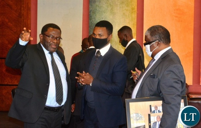 FORMER Cabinet, Peter Machungwa(left) confers Darlington Chiluba(m)a and former Press aide, Richard Sakala during the 2nd memorial lecture in honour of late republican president Dr. Titus Chiluba in Lusaka