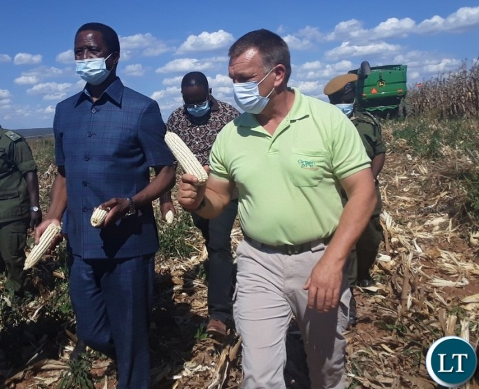 President Edgar Lungu with Green 2000 Agricultural Equipment and know- how limited General Manager Dawid Durandt display cobs of maize during the launch of this year's harvesting season in Kawambwa District. Picture by SUNDAY BWALYA/ ZANIS
