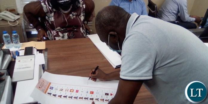 PF Deputy National Chairperson Davis Chama pending signature presidential ballot sheet in Dubai, UAE