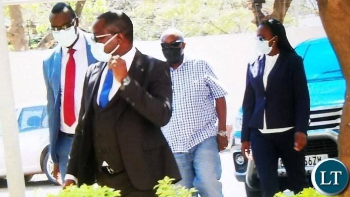 Faith Musonda in the company of her lawyers Makebi Zulu and Jonas Zimba at Zambia Police headquarters.