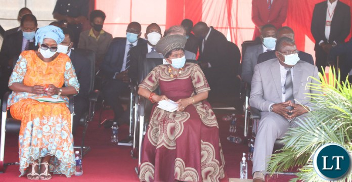 Chieftiness Nkomesha Mukamombo II with Minister of Health Sylvia Masebo following the proceeding during the relaunch of COVID-19 vaccine at OYDC