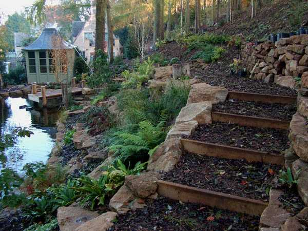 Wooden Outdoor Stairs and Landscaping Steps on Slope ... on Wooded Backyard Ideas id=92823