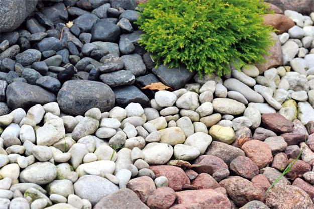 25 Beautiful Landscaping Ideas Adding Beach Stones to ... on Pebble Patio Ideas id=21954