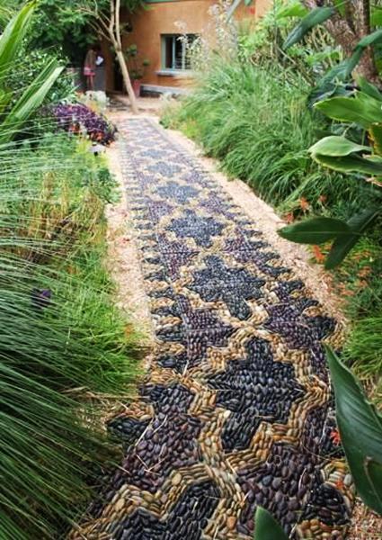 25 Unique Backyard Landscaping Ideas and Garden Path ... on Backyard Pebbles Design id=50735