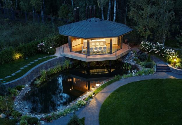 Spectacular Gazebo Design With Glass Floor In Dining Area